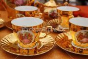 dep_5568977-Ancient-golden-porcelain-cups-coffe-or-tea