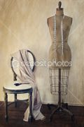 dep_7006694-Antique-dress-form-and-chair-with-vintage-feeling